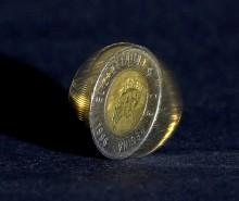 Le dollar, les commentaires et M. Harper!